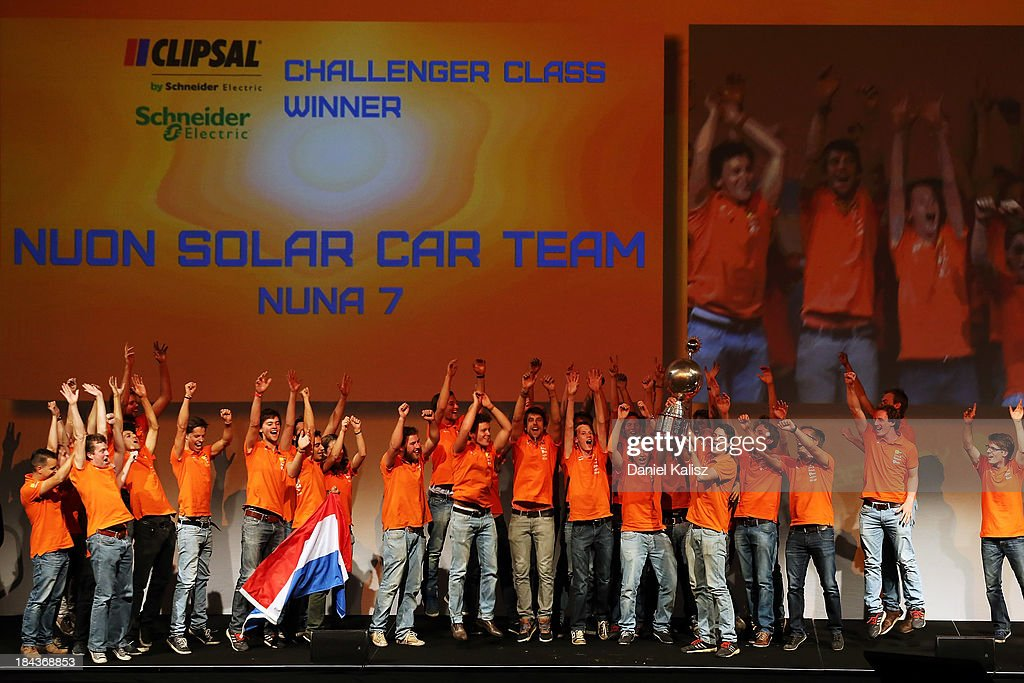 Nuon Solar Car Team, Delft University of Technology from the Netherlands receives the trophy for Challenger Class Winner and outright victory in the 2013 World Solar Challenge on October 13, 2013 in Adelaide, Australia. Over 25 teams from across the globe competed in the 2013 World Solar Challenge, a 3000 km solar-powered vehicle race between Darwin and Adelaide, which was won by Dutch team Nuon from the Delft University of Technology.
