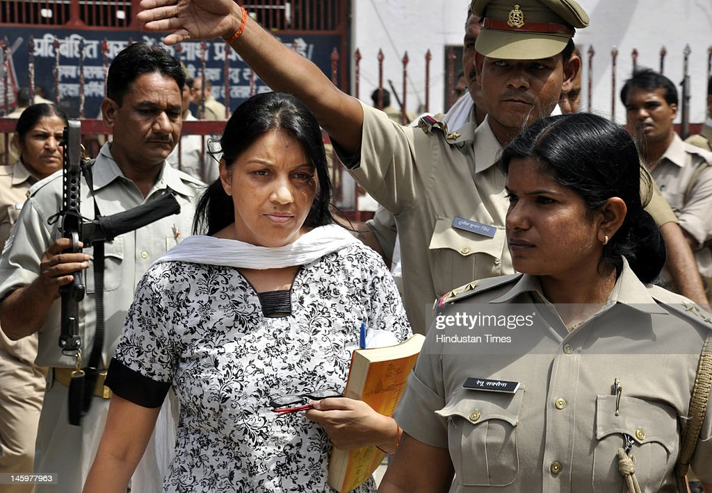 Nupur Talwar being escorted by the Police on her way to the CBI Court on June 8, 2012 in Ghaziabad, India. Nupur Talwar along with her husband Rajesh Talwar are facing charge of double murder of their daughter Aarushi and help Hemraj. Court has begin examining prosecution witnesses in the case.