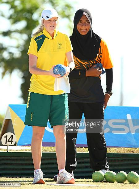 Nur Ain Nabilah Tarmizi of Malaysia and Ellen Ryan of Australia bowl during the Girls Singles Lawn Bowls at the Tuanaimato Sports Facility on day one...