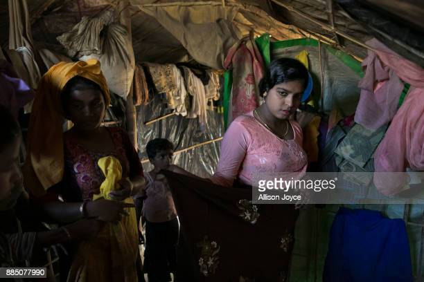 COX'S BAZAR BANGLADESH NOVEMBER 30 Nur Begum who doesn't know her age but thinks she is between 14 and 16 years old is seen on the day of her wedding...