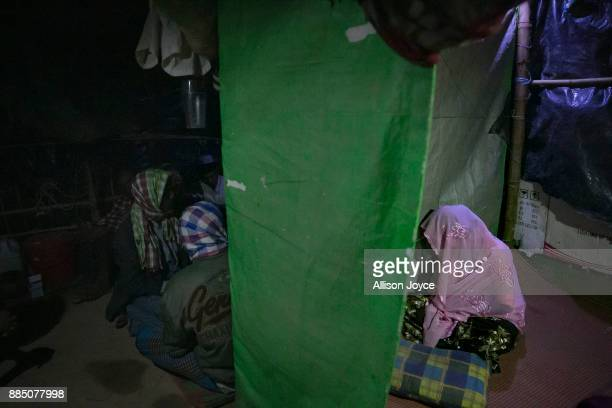 COX'S BAZAR BANGLADESH NOVEMBER 30 Nur Begum who doesn't know her age but thinks she is between 14 and 16 years old sits segregated from men on the...