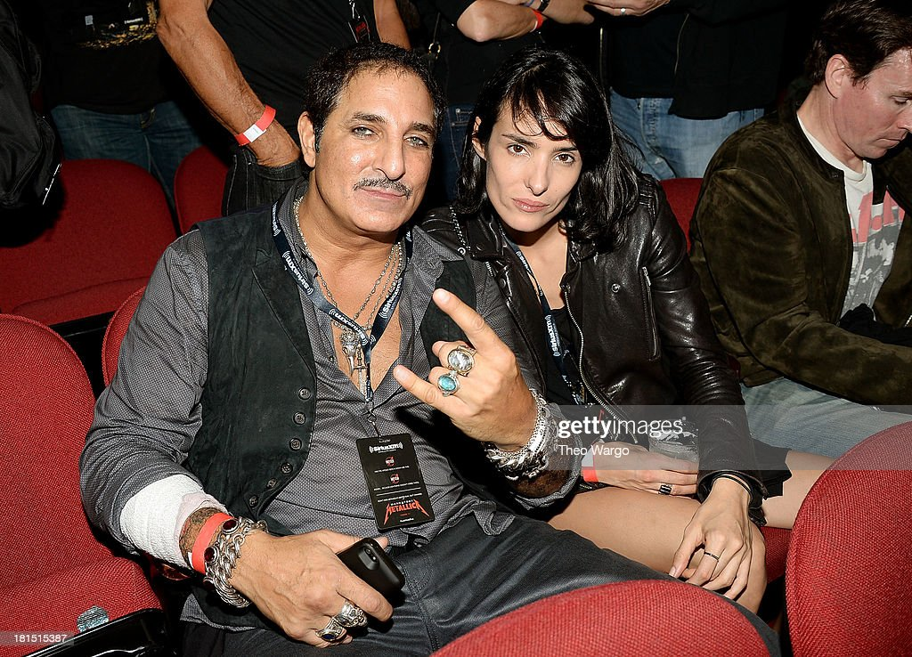 Nur Kahn (L) attends Metallica's private, exclusive concert for SiriusXM listeners at The Apollo Theater on September 21, 2013 in New York City.