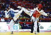 Nur Tatar of Turkey competes with Chia Chia Chuang of Taiwan during the women's 67 kg final match of WTF World Taekwondo Championships 2015 at the...