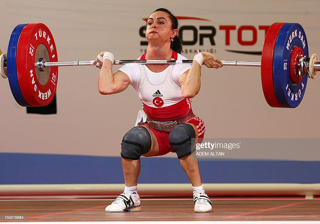 Nurcan Taylan of Turkey celebrates her new world record at the women's 48kg weightlifting clean and jerk competition at the World Weightlifting...