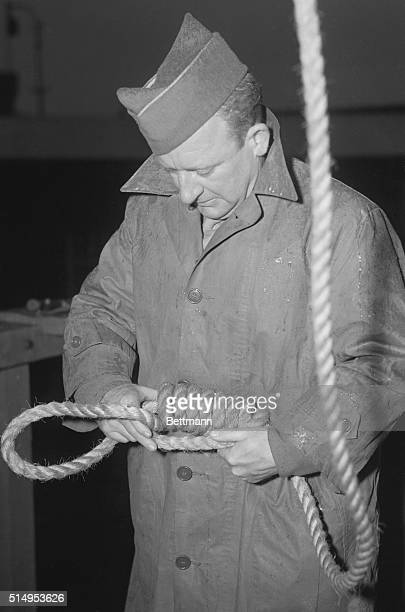 Nazi necklace being prepared by M/Sgt John C Woods official Hangman for the European Theater of Operations with 92 hangings to his credit He is...
