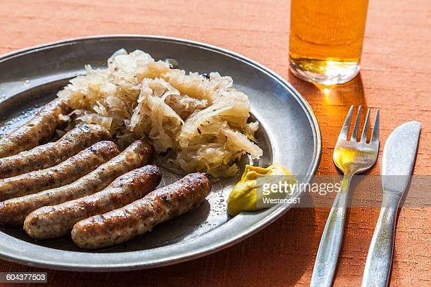 Nuremberg grilled sausages, sauerkraut and mustard on plate