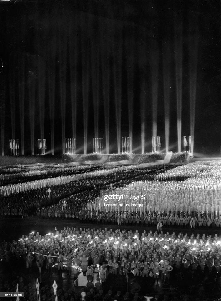 Nuremberg. Reich Party Rally. 140,000 people on the Zeppelin Field. 1933. Germany. Photograph. (Photo by Imagno/Getty Images) Nürnberg. Reichsparteitag der NSDAP. 140.000 Menschen auf der Zeppelinwiese. 1933. Photographie.