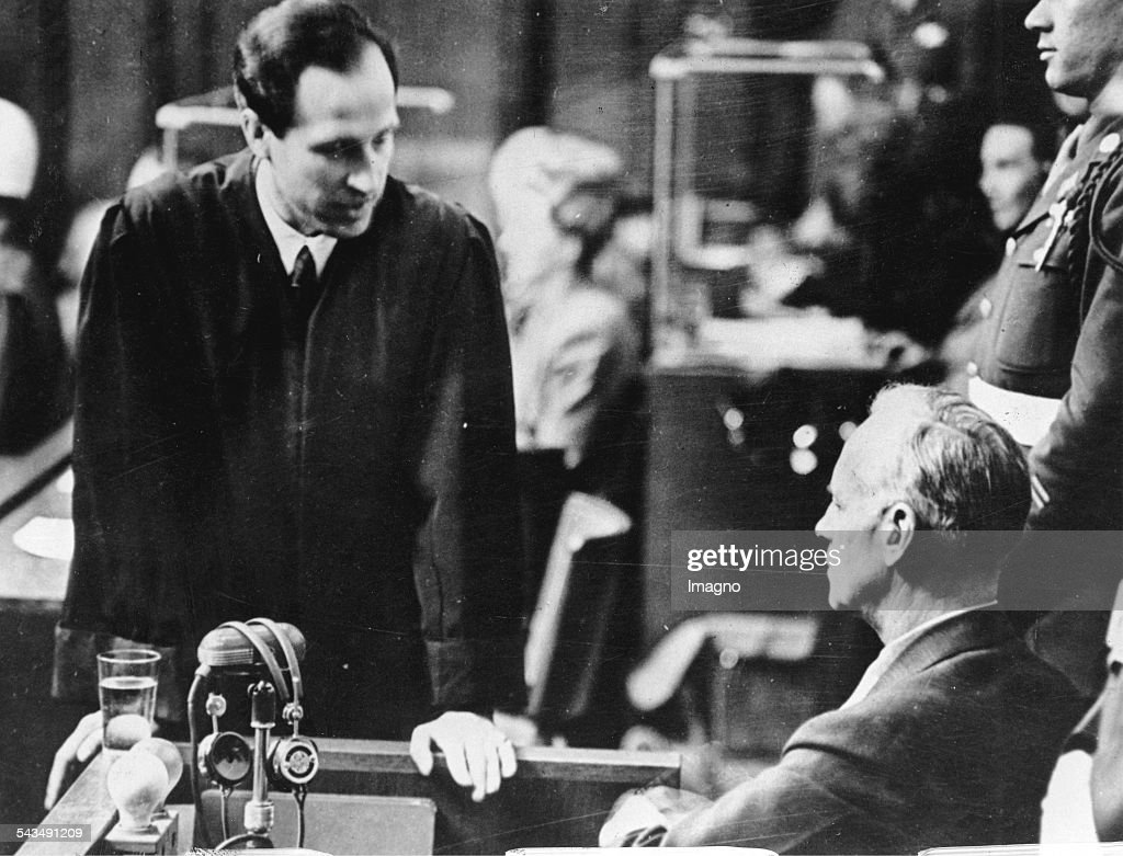 Nuremberg Trial. Joachim von Ribbentrop talks to his lawyer. Photograph. Germany. 1946.