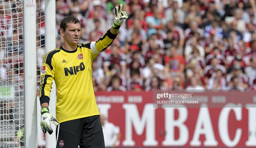 Nuremberg's goalkeeper Raphael Schaefer gestures during the German first division Bundesliga football match FC Nuernberg vs Hertha Berlin in Nuremberg, southern Germany, on August 18, 2013. The match ended 2-2.