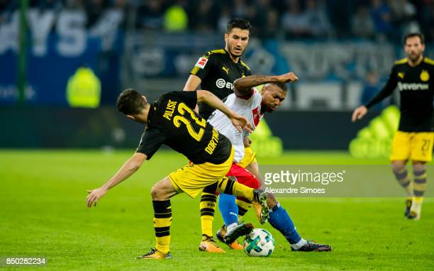 Nuri Sahin and Christian Pulisic of Borussia Dortmund challenges Souza Silva Walace of Hamburger SV during the Bundesliga match between Hamburger SV...