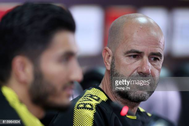Nuri Sahin and head coach Peter Bosz of Dortmund attends press conference ahead of the 2017 International Champions Cup football match between AC...