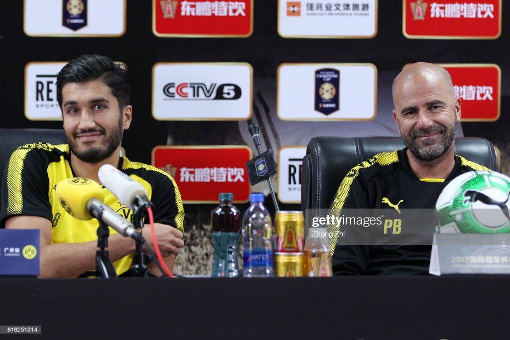 Nuri Sahin(L) and head coach Peter Bosz(R) of Dortmund attends press conference ahead of the 2017 International Champions Cup football match between AC Milan and Borussia Dortmund at University Town Sports Centre Stadium on July 17, 2017 in Guangzhou, China.