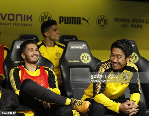 Nuri Sahin and Shinji Kagawa of Borussia Dortmund gesture ahead of the Bundesliga soccer match between Borussia Dortmund and Borussia...