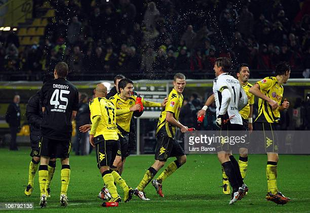 Nuri Sahin and Sven Bender of Dortmund celebrate with team mates after winning the Bundesliga match between Borussia Dortmund and Hamburger SV at...