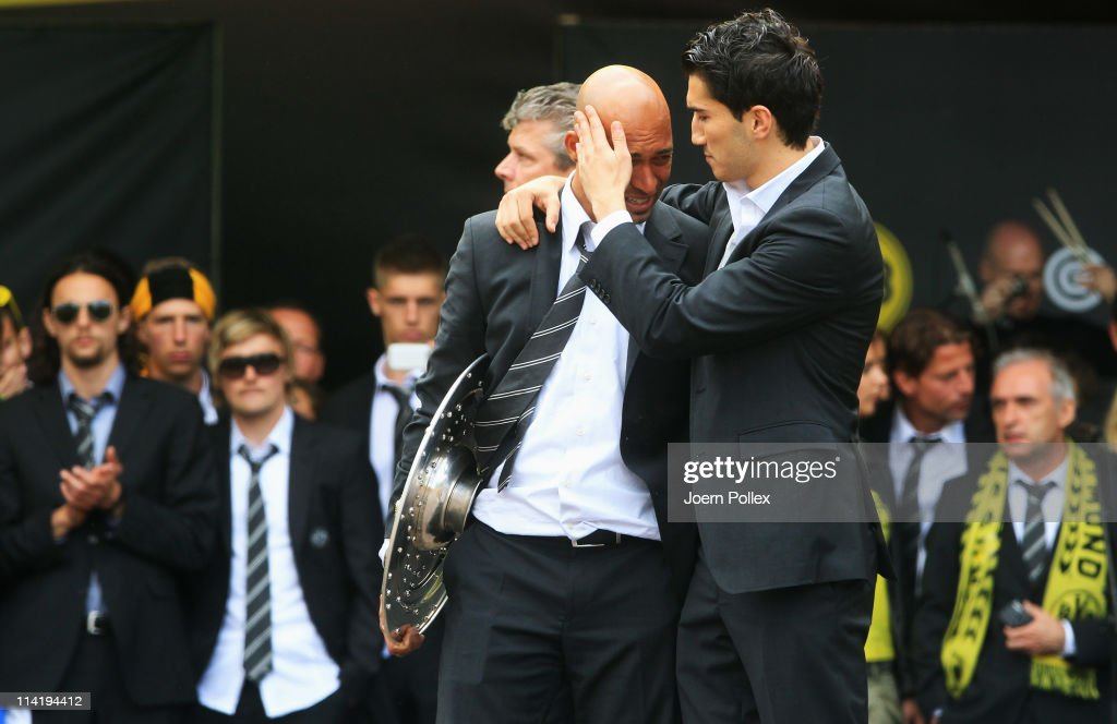 Nuri Sahin (R) comforts Dede of Dortmund during they celebrates with the fans winning the German Championship at the Westfalenhalle on May 15, 2011 in Dortmund, Germany.