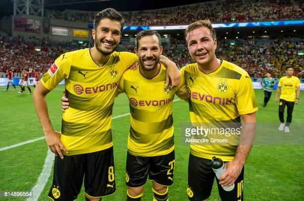 Nuri Sahin Gonzalo Castro and Mario Goetze of Borussia Dortmund during the preseason friendly match between Urawa Red Diamonds and Borussia Dortmund...