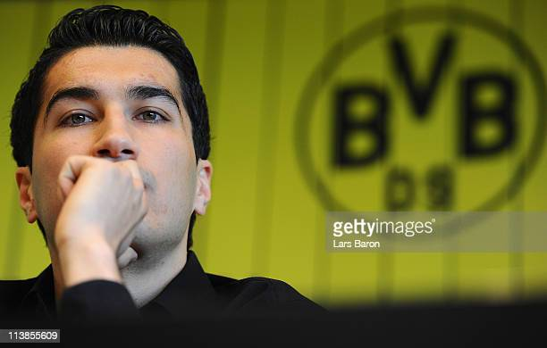 Nuri Sahin looks on during a Borussia Dortmund press conference at Signal Iduna Park on May 9 2011 in Dortmund Germany Today Dortmund confirmed the...