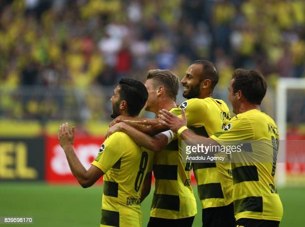 Nuri Sahin Lukasz Piszczek Omer Toprak and Mario Gotze of Borussia Dortmund celebrate after scoring a goal during the Bundesliga soccer match between...