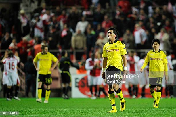 Nuri Sahin of Borussia Dortmund and Shinji Kagawa of Borussia Dortmund look dejected side Frederic Kanoute of Sevilla FC scored his team's second...