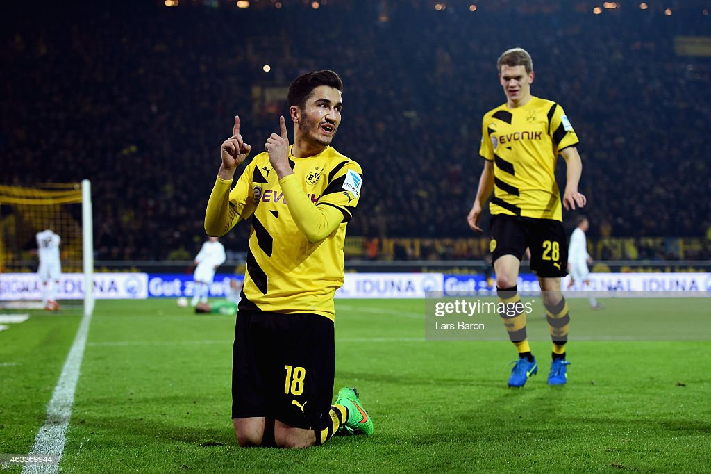 <a gi-track='captionPersonalityLinkClicked' href=/galleries/search?phrase=Nuri+Sahin&family=editorial&specificpeople=609186 ng-click='$event.stopPropagation()'>Nuri Sahin</a> of Borussia Dortmund celebrates as he scores the fourth goal during the Bundesliga match between Borussia Dortmund and 1. FSV Mainz 05 at Signal Iduna Park on February 13, 2015 in Dortmund, Germany.
