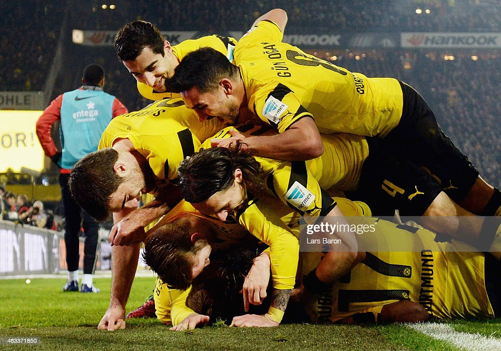 Nuri Sahin of Borussia Dortmund celebrates with team mates as he scores the fourth goal during the Bundesliga match between Borussia Dortmund and 1...