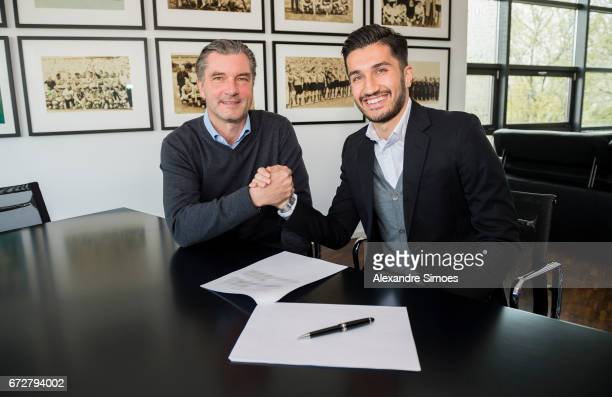 Nuri Sahin of Borussia Dortmund extends his contract until 2019 at the office of Sports Director of Borussia Dortmund Michael Zorc on April 25 2017...