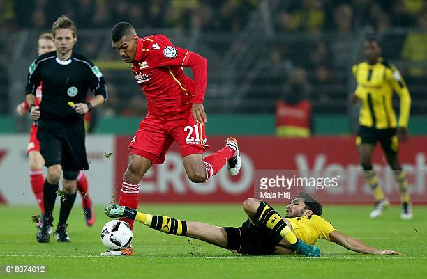 Nuri Sahin of Dortmund and Collin Quaner of Berlin battle for the ball during DFB Cup second round match between Borussia Dortmund and 1 FC Union...