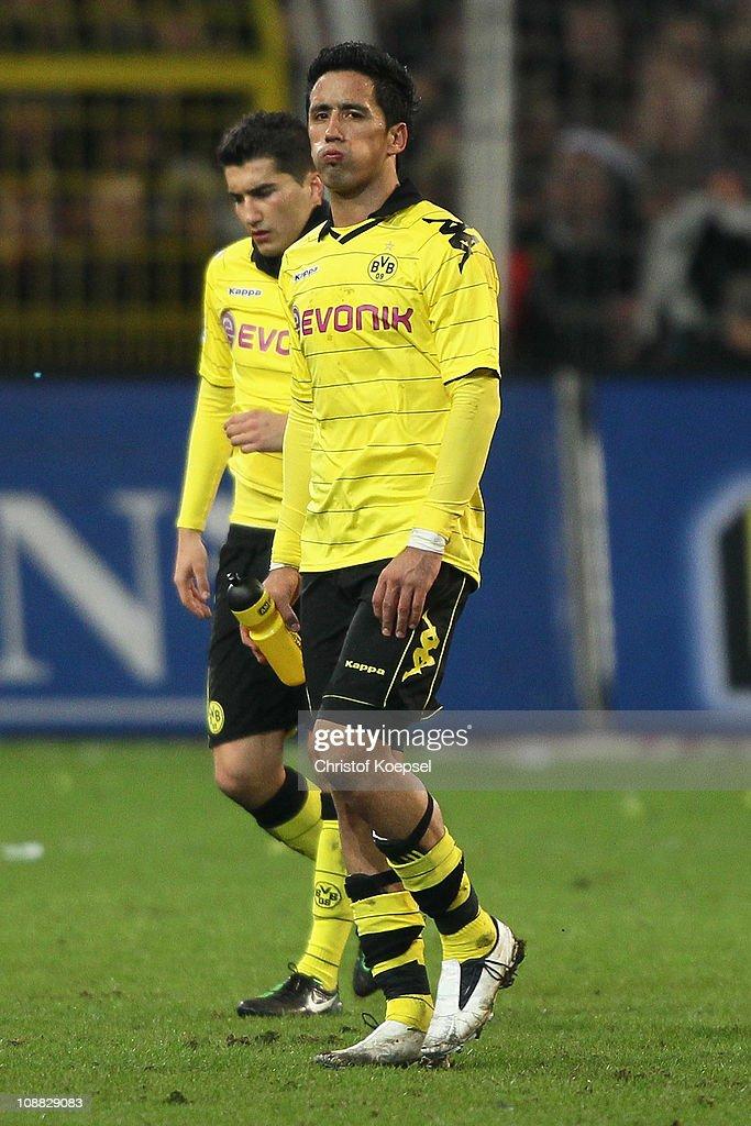 Nuri Sahin of Dortmund and Lucas Barrios of Dortmund look dejected after the 0-0 draw of the Bundesliga match between Borussia Dortmund and FC Schalke 04 at Signal Iduna Park on February 4, 2011 in Dortmund, Germany.