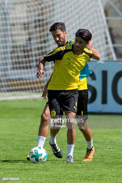 Nuri Sahin of Dortmund and Mahmound Dahoud of Dortmund battle for the ball during a training session as part of the training camp on July 30 2017 in...