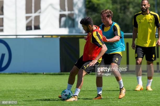 Nuri Sahin of Dortmund and Mario Goetze of Dortmund battle for the ball during a training session as part of the training camp on July 30 2017 in Bad...