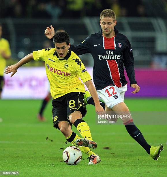 Nuri Sahin of Dortmund and Mathieu Bodmer of Paris battle for the ball during the UEFA Champions League Group J match between Borussia Dortmund and...