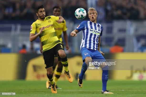 Nuri Sahin of Dortmund and Per Ciljan Skjelbred of Berlin during the Bundesliga match between Borussia Dortmund and Hertha BSC at Signal Iduna Park...