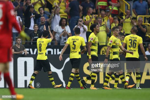 Nuri Sahin of Dortmund applauds to the fans after he scored to make it 20 during the Bundesliga match between Borussia Dortmund and Hertha BSC at...
