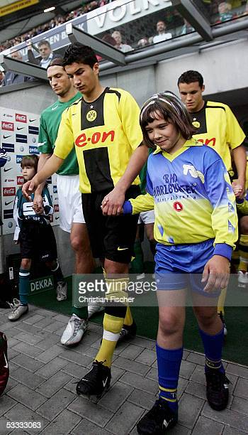 Nuri Sahin of Dortmund arrives the pitch as the youngesd player in history during the Bundesliga match between VFL Wolfsburg and Borussia Dortmund at...