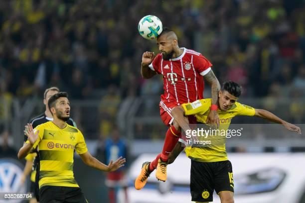 Nuri Sahin of Dortmund Arturo Vidal of Bayern Muenchen and Mahmound Dahoud of Dortmund battle for the ball during the DFL Supercup 2017 match between...