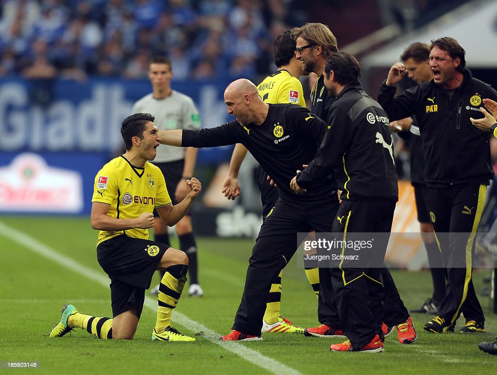 <a gi-track='captionPersonalityLinkClicked' href=/galleries/search?phrase=Nuri+Sahin&family=editorial&specificpeople=609186 ng-click='$event.stopPropagation()'>Nuri Sahin</a> of Dortmund (L) celebrates after scoring during the Bundesliga match between Schalke 04 and Borussia Dortmund at Veltins-Arena on October 26, 2013 in Gelsenkirchen, Germany.