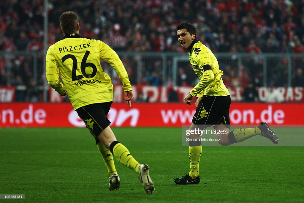 <a gi-track='captionPersonalityLinkClicked' href=/galleries/search?phrase=Nuri+Sahin&family=editorial&specificpeople=609186 ng-click='$event.stopPropagation()'>Nuri Sahin</a> (R) of Dortmund celebrates after scoring his team's second goal during the Bundesliga match between FC Bayern Muenchen and Borussia Dortmund at Allianz Arena on February 26, 2011 in Munich, Germany.