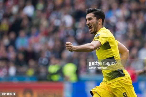 Nuri Sahin of Dortmund celebrates his team's first goal goal during the Bundesliga match between Eintracht Frankfurt and Borussia Dortmund at...