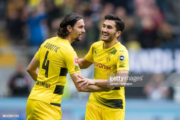 Nuri Sahin of Dortmund celebrates his team's first goal with team mate Neven Subotic during the Bundesliga match between Eintracht Frankfurt and...