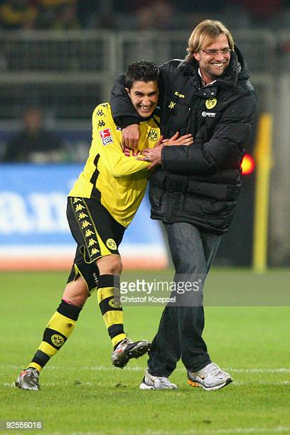 Nuri Sahin of Dortmund celebrates the 20 victory with head coach Juergen Klopp after the Bundesliga match between Borussia Dortmund and Hertha BSC...