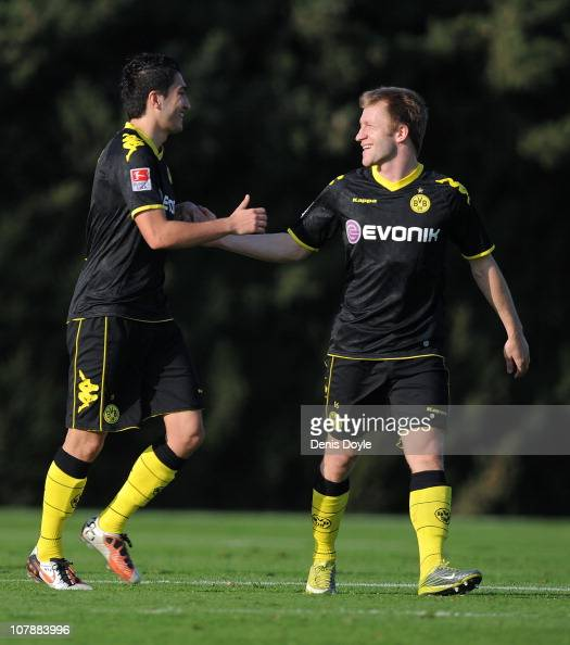 Nuri Sahin of Dortmund celebrates with Kuba after scoring a goal against Lens during the friendly match between Borussia Dortmund and Lens at the...