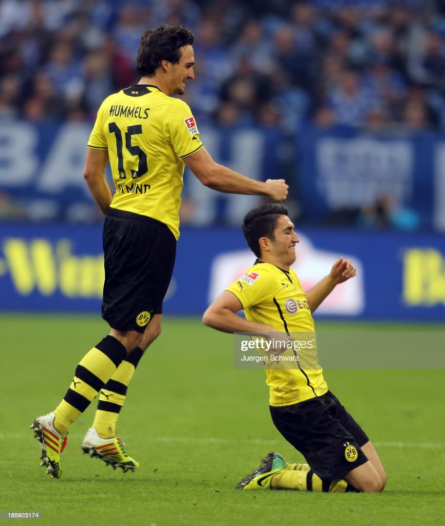 <a gi-track='captionPersonalityLinkClicked' href=/galleries/search?phrase=Nuri+Sahin&family=editorial&specificpeople=609186 ng-click='$event.stopPropagation()'>Nuri Sahin</a> of Dortmund (R) celebrates with <a gi-track='captionPersonalityLinkClicked' href=/galleries/search?phrase=Mats+Hummels&family=editorial&specificpeople=595395 ng-click='$event.stopPropagation()'>Mats Hummels</a> after scoring during the Bundesliga match between Schalke 04 and Borussia Dortmund at Veltins-Arena on October 26, 2013 in Gelsenkirchen, Germany.
