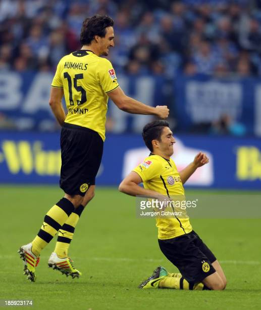 Nuri Sahin of Dortmund celebrates with Mats Hummels after scoring during the Bundesliga match between Schalke 04 and Borussia Dortmund at...