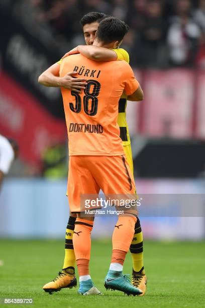 Nuri Sahin of Dortmund celebrates with Roman Buerki of Dortmund after he scored a goal to make it 01 during the Bundesliga match between Eintracht...