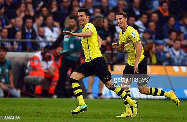 Nuri Sahin of Dortmund celebrates with team mates after scoring his teams second goal during the Bundesliga match between FC Schalke 04 and Borussia...