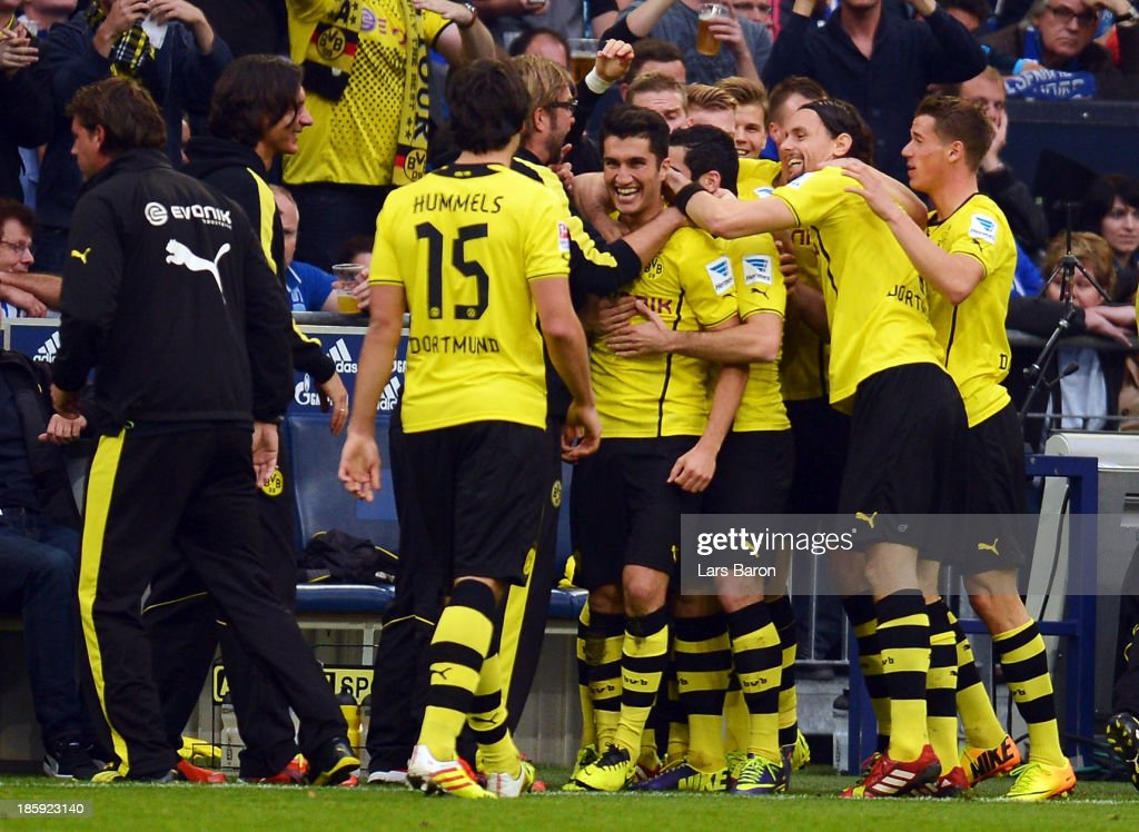 <a gi-track='captionPersonalityLinkClicked' href=/galleries/search?phrase=Nuri+Sahin&family=editorial&specificpeople=609186 ng-click='$event.stopPropagation()'>Nuri Sahin</a> of Dortmund celebrates with team mates after scoring his teams second goal during the Bundesliga match between FC Schalke 04 and Borussia Dortmund at Veltins-Arena on October 26, 2013 in Gelsenkirchen, Germany.