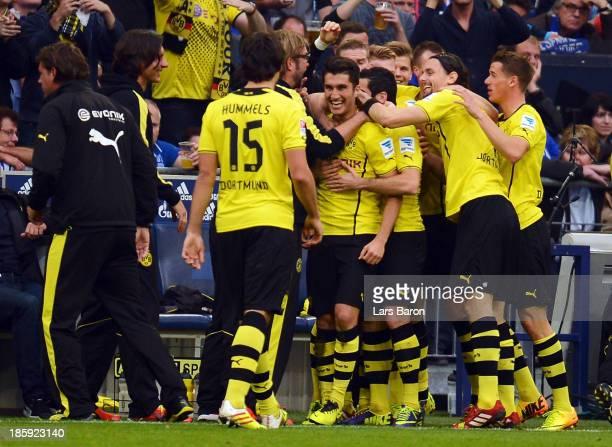 Nuri Sahin of Dortmund celebrates with team mates after scoring his teams second goal during the Bundesliga match between FC Schalke 04 and Borussia...