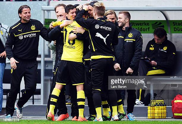 Nuri Sahin of Dortmund celebrates with team mates Roman Weidenfeller Robert LEwandowski Marco Reus and Jakub Blaszczykowski after scoring his teams...
