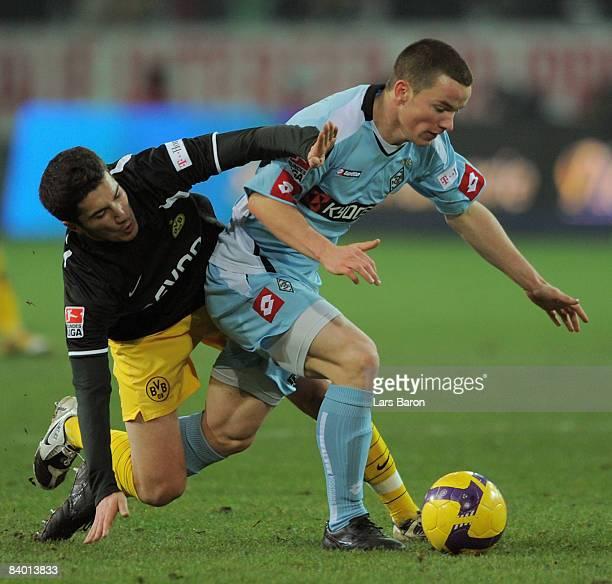 Nuri Sahin of Dortmund challenges Alexander Baumjohann of Moenchengladbach during the Bundesliga match between Borussia Dortmund and Borussia...