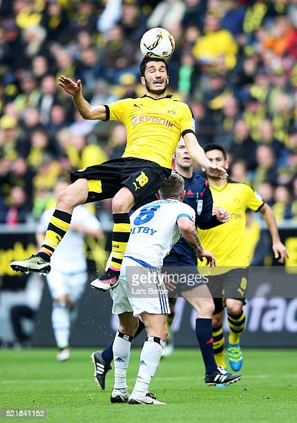 Nuri Sahin of Dortmund falls over Levis Holtby of Hamburg during the Bundesliga match between Borussia Dortmund and Hamburger SV at Signal Iduna Park...